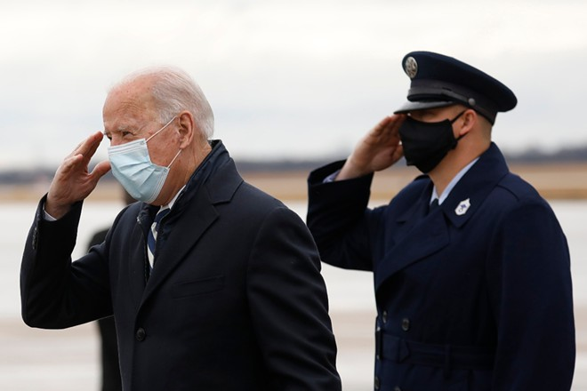 President Joe Biden salutes as he departs Air Force One at Joint Base Andrews in Maryland, March 1, 2021. - YURI GRIPAS/THE NEW YORK TIMES