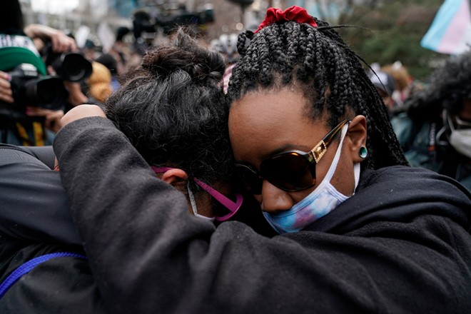 People hug outside the Hennepin Country Government Center in Minneapolis on Tuesday, April 20, 2021, after the jury delivered three guilty verdicts in the Derek Chauvin trial. Chauvin, a former Minneapolis police officer was charged in the death of George Floyd while in police custody last year. - AMR ALFIKY/THE NEW YORK TIMES