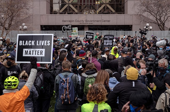 People gather outside the Hennepin Country Government Center in Minneapolis on Tuesday, April 20, 2021, as the jury prepares to deliver a verdict in the Derek Chauvin trial. Chauvin, a former Minneapolis police officer is charged in the death of George Floyd while in police custody last year. - AMR ALFIKY/THE NEW YORK TIMES