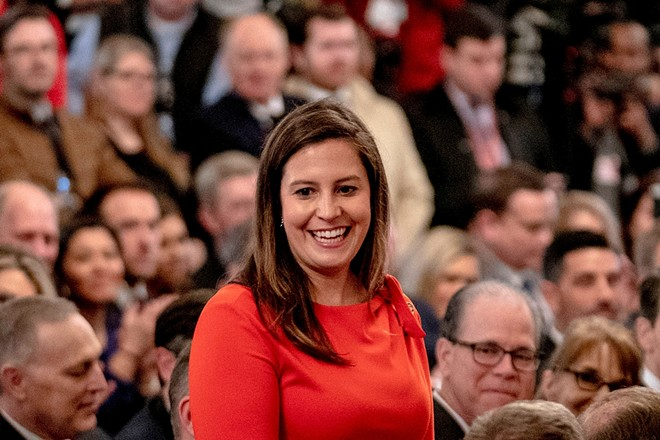 Rep. Elise Stefanik (R-N.Y.) stands as then President Donald Trump recognizes her for her work during the impeachment hearings at the White House in Washington, Feb. 6, 2020. House Minority Leader Kevin McCarthy (R-Calif.) on Sunday, May 9, 2021, officially endorsed Stefanik in her bid to oust the No. 3 House Republican, Rep. Liz Cheney (R-Wyo.). - ANNA MONEYMAKER/THE NEW YORK TIMES