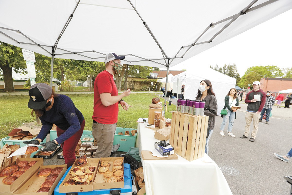 The Grain Shed owner Teddy Benson and Market Coordinator Natalie Weinmeister at the South Perry Thursday Market last year. - YOUNG KWAK PHOTO