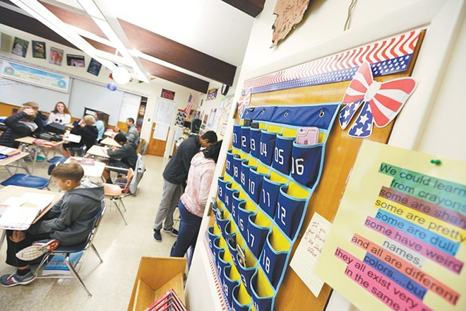 An eighth-grade social studies class at Spokane's Sacajawea Middle School asked kids to clean cotton. - YOUNG KWAK PHOTO