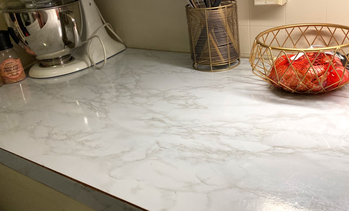 Marble-patterned contact paper is an affordable and easy way to update your countertops. - SAMANTHA WOHLFEIL PHOTO
