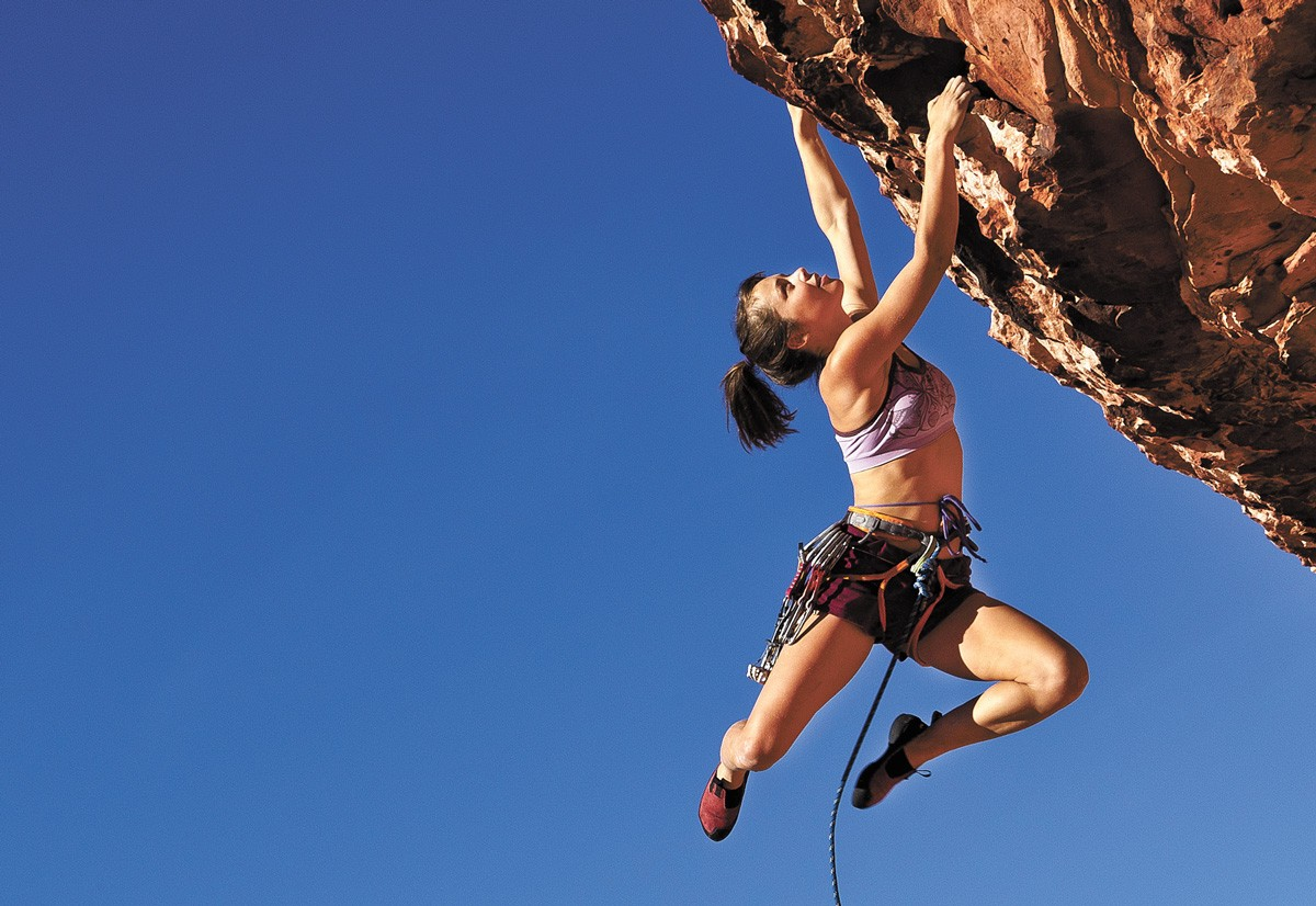 There are two main types of outdoor climbing: Sport climbing involves climbing on routes with permanently fixed anchors. Trad (traditional) climbing involves placing your own anchors on the rock while you climb.