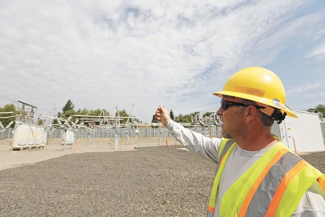 Avista Utilities Substation Inspector Joe Vigliotta describes the elements of a substation near Avista's Spokane headquarters. - YOUNG KWAK PHOTO
