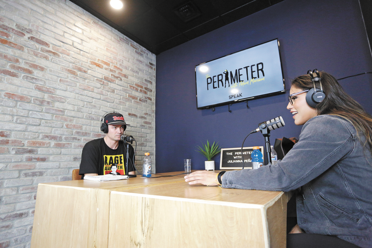 Host Adam Morrison, left, interviews Ultimate Fighting Championship competitor Julianna Peña during his podcast in May. - YOUNG KWAK PHOTO