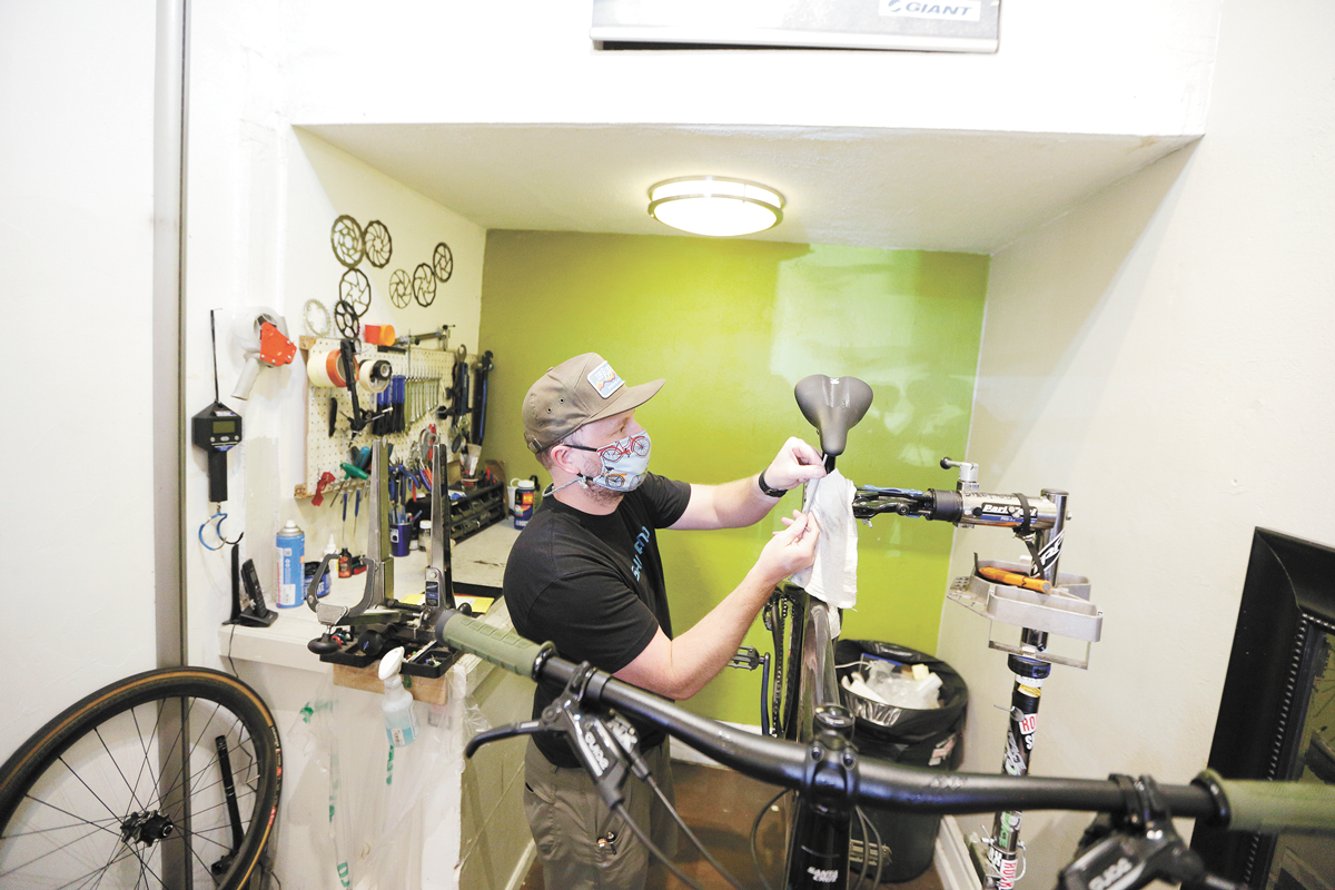 The Bike Hub downtown store Manager Tim Dunn hard at work. - YOUNG KWAK PHOTO