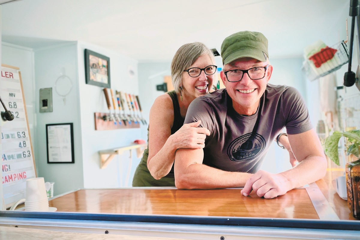 Laurie Ann Greenberg and Blaise Barshaw in the beer trailer. - LAUREN REY PHOTO