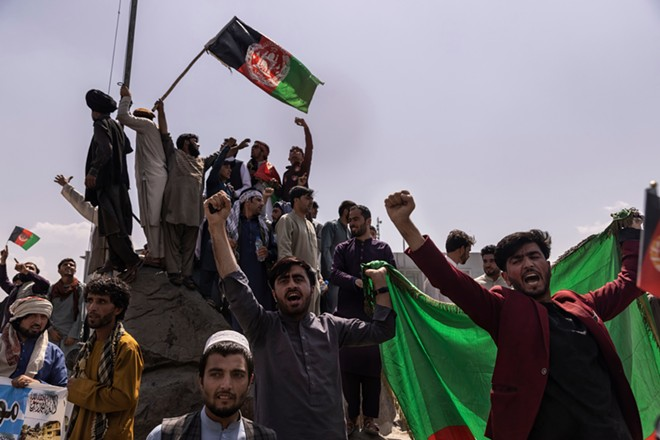 Protesters rally against Taliban rule in Kabul, Afghanistan  on Thursday, Aug. 19, 2021. Protesters took to the streets to rally against Taliban rule for the second day on Thursday, this time marching in Kabul, including near the presidential palace. - VICTOR J. BLUE/THE NEW YORK TIMES