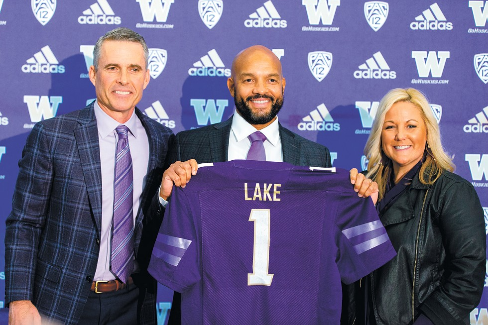 Jimmy Lake's long and winding road from North Central High led to being hired as head coach at the University of Washington on Dec. 2, 2019. At the announcement, he was joined by his former boss and mentor Chris Petersen and his current boss, UW Director of Athletics Jennifer Cohen. - SCOTT EKLUND PHOTO/RED BOX PICTURES