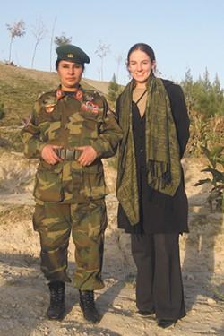 Civilian counternarcotics advisor Eleanor Baumgartner (right) with Brigadier General Khatool Mohammadzai, the first female paratrooper in Afghanistan. - COURTESY OF ELEANOR BAUMGARTNER