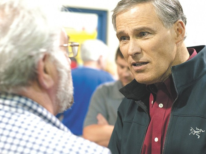 """Washington Gov. Jay Inslee is trying to avoid swallowing a """"poison pill"""" in the battle against climate change."""