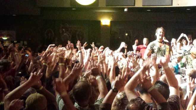 Michael Franti on one of his excursions into the audience Monday night. - DAN NAILEN