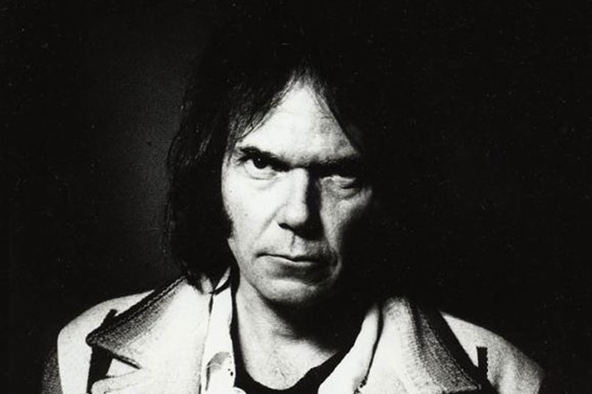 Hopefully, Neil Young is happier than this to perform in  Spokane this fall.