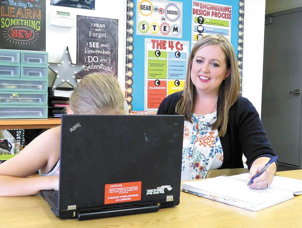 With 30 extra minutes at Linwood Elementary, content specialist Emily O'Halloran has time to teach students special science lessons using technology.