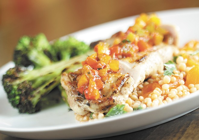 Grilled chicken apricot fregula and diavolo sauce at Italia Trattoria. - YOUNG KWAK