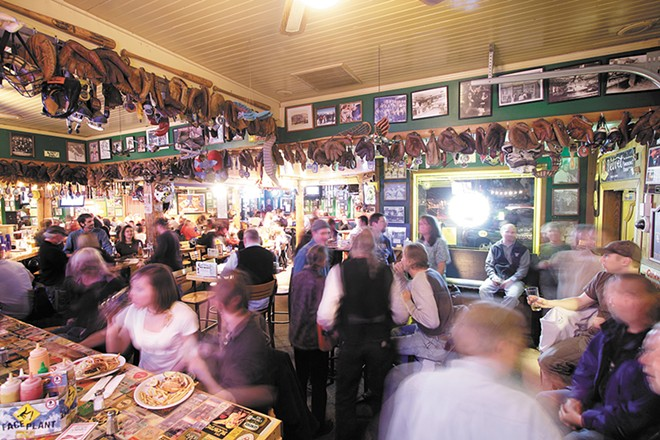 Capone's Pub & Grill in Coeur d'Alene is buzzing during happy hour. - YOUNG KWAK