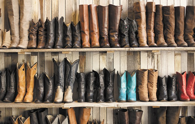 Walls of vintage boots are on display at Vintage Angel. - YOUNG KWAK