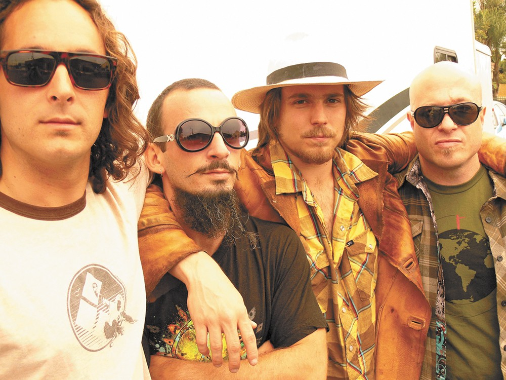 Lukas Nelson (in the hat) and Promise of the Real recorded an album with Neil Young and are now on tour with him.