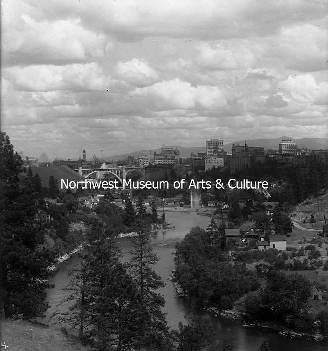 Another lovely view of our fair city, looking east from where the Centennial Trail now extends along the Spokane River, through Kendall Yards. That's Peaceful Valley to the right. Photo taken in 1912, from the Frank Palmer collection. - MAC