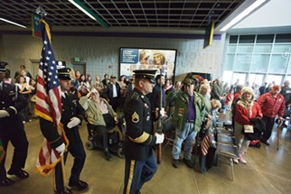 A scene from 2013's Veterans Day ceremony at the Spokane Arena. - YOUNG KWAK