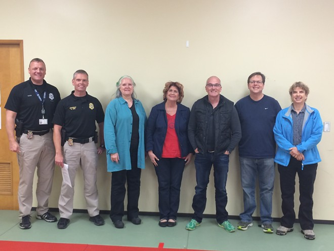 Officer Ryan Snider (left), Lt. Kevin King, Deb Conklin, Jenny Rose, Ladd Smith, Breean Beggs and Marty Huseman - MITCH RYALS