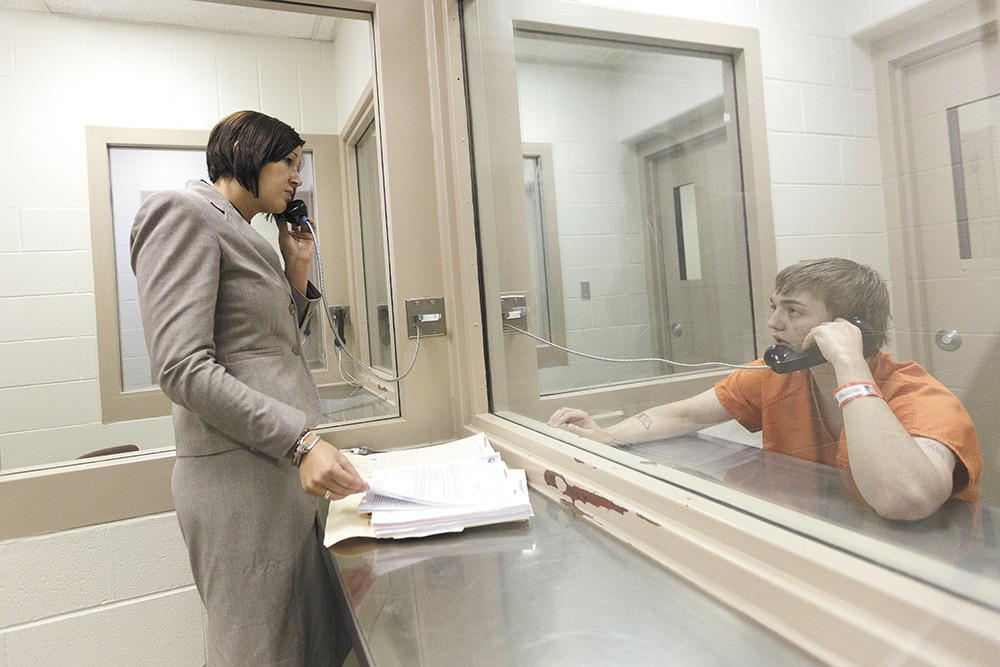 Lisa Chesebro, a Kootenai County public defender, meets with Gavin Ottomeier, who is facing a felony charge of intent to deliver marijuana that carries a possible five-year prison sentence. - YOUNG KWAK