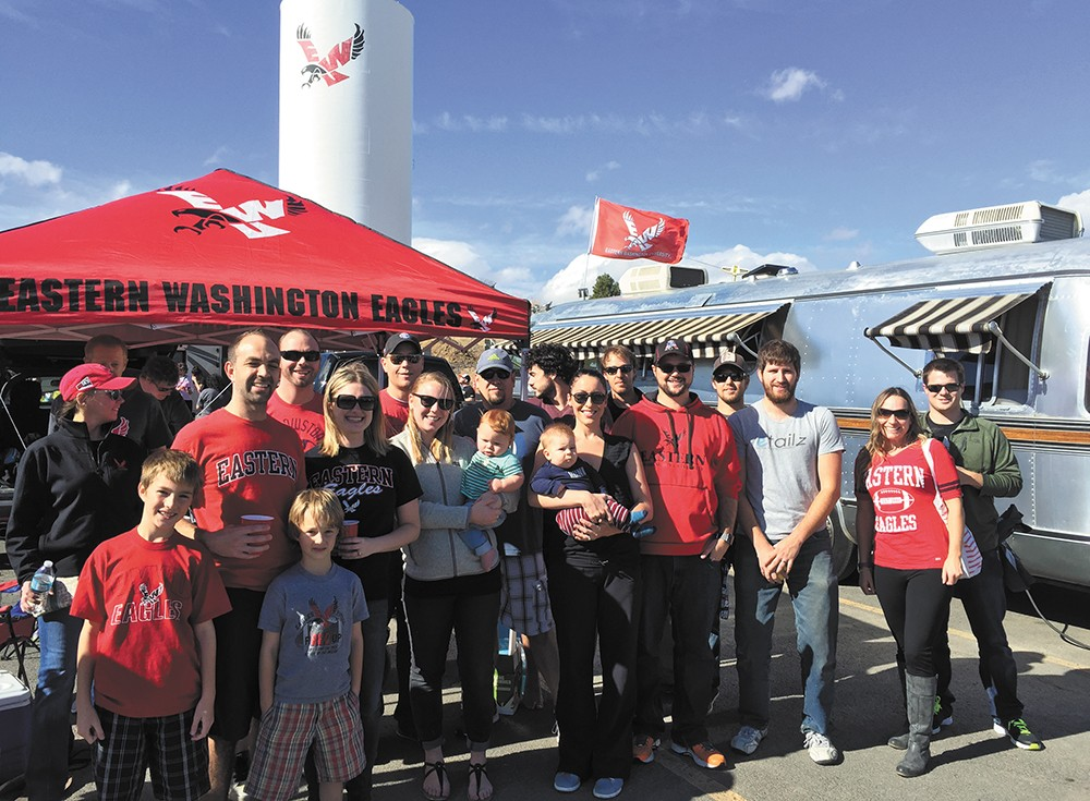 Scott and Andrea LaPlant host a big crew before a recent home game at Roos Field. - MAX CARTER