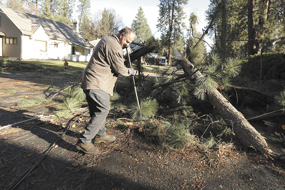 Tens of thousands remained in the dark as a winter storm warning came a week after the windstorm. - YOUNG KWAK