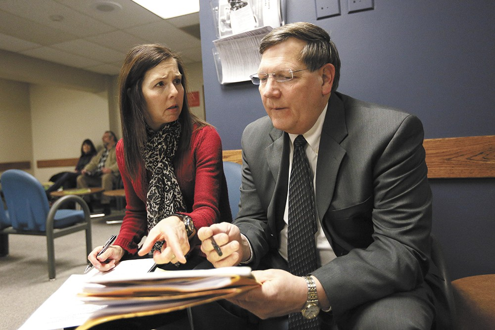 Spokane County Public Defender Dave Carter prepares for a hearing with Tracey Cook, a facilitator in juvenile court. - YOUNG KWAK