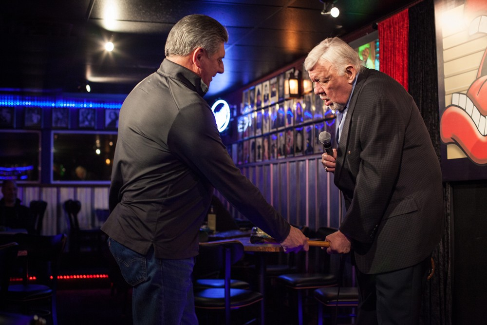 """Don """"Uncle D"""" Parkins hands Jay Wendell Walker his cane at open mic night at Parkins' club. - KIRSTEN BLACK"""