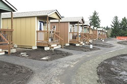 More teenie-weenie houses like these, from Olympia, will be coming to Spokane - TIM RANSOM PHOTO