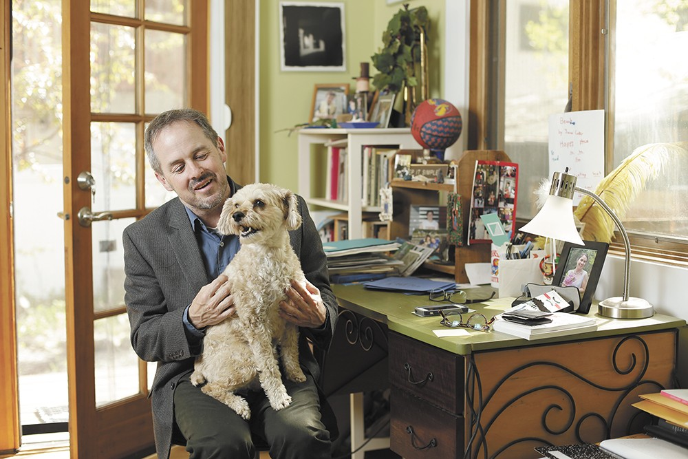 "The poet and his dog, Teddy, in his home office. Says Tod Marshall: ""When I was in high school, I hated poetry."" - YOUNG KWAK"