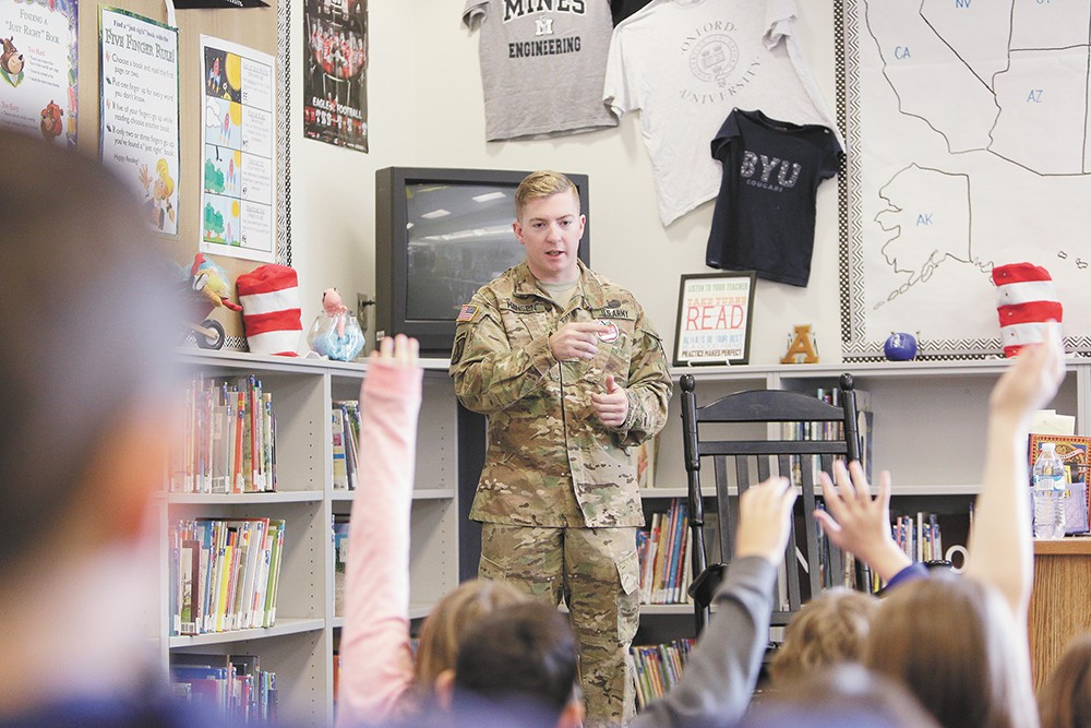 Army Spc. Chris Hansen, stationed at Fort Drum, N.Y., visits a first-grade class at Adams Elementary School, where he was once a student. - YOUNG KWAK