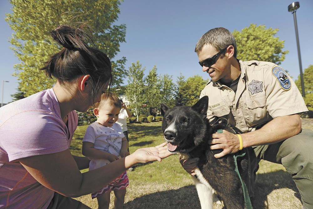 Karelian bear dog Jax meets the public with his handler, Officer Keith Kirsch. - YOUNG KWAK