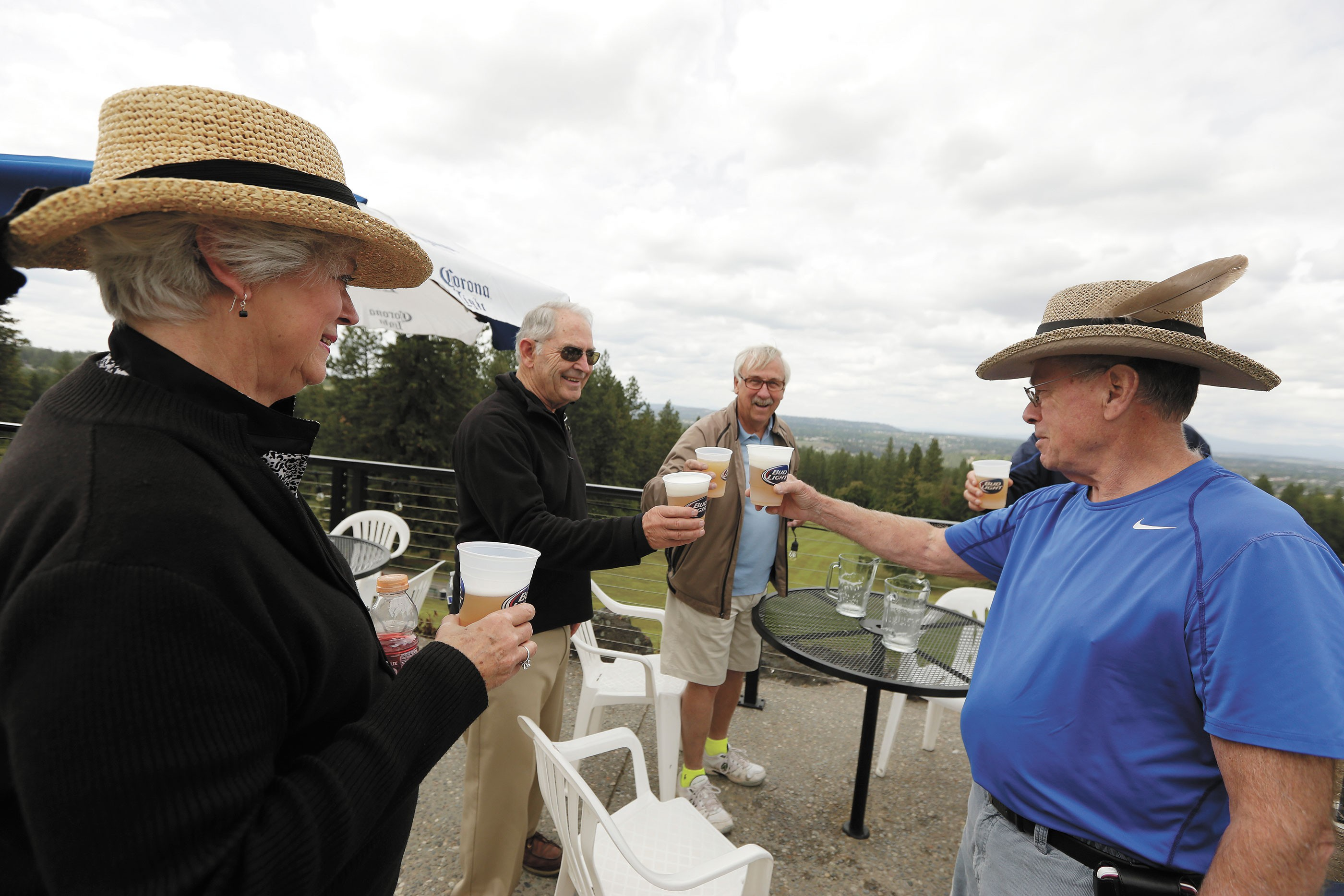 ROM LEFT: Judy Van Hersett, Dave Van Hersett, Gary Grainer and Bob Tenold toast on the patio at the Grill at Indian Canyon Golf Course. - YOUNG KWAK