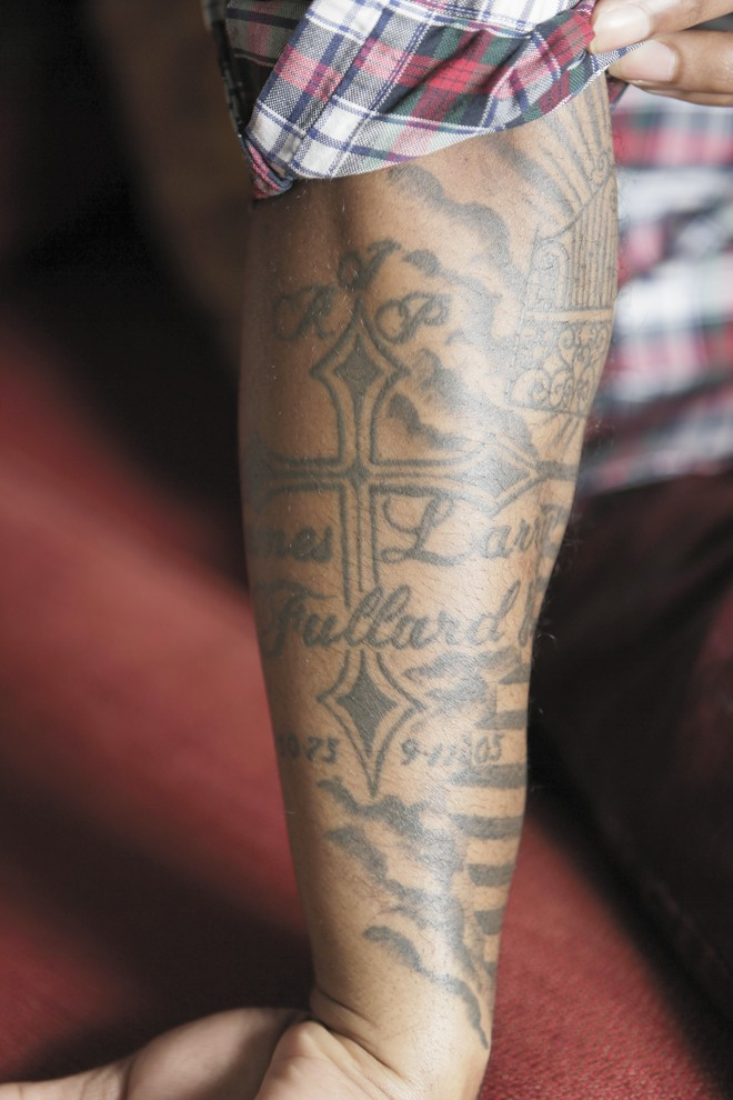 LaShawn Jameison's right forearm is covered in tattoos honoring his family. The cross is in memory of his father, who was killed when he was 11. - YOUNG KWAK