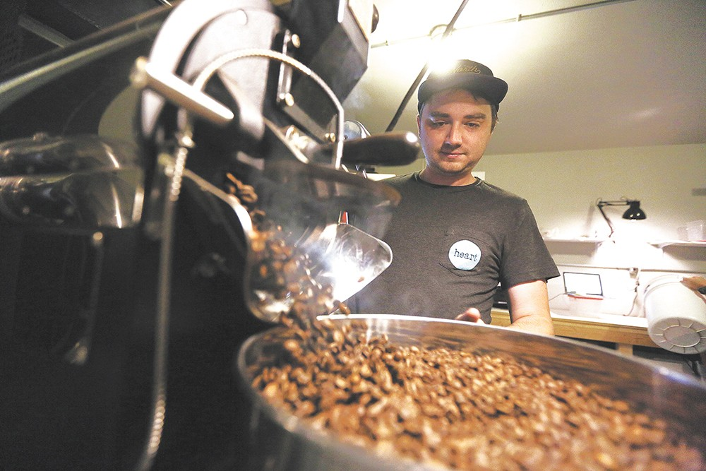 Vessel's lead roaster Jeremy Williamson finishes a batch of coffee at the company's newly opened space. - YOUNG KWAK