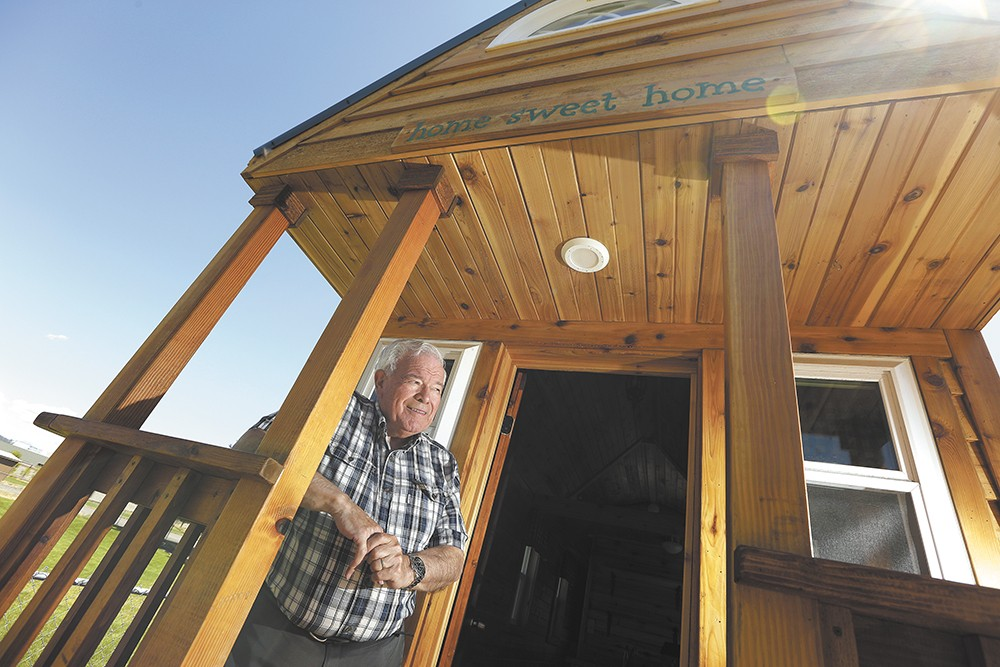 """""""This is a thing that appeals to Republicans and Democrats,"""" says Ian Robertson on his planned tiny-house village in Spokane Valley. - YOUNG KWAK"""