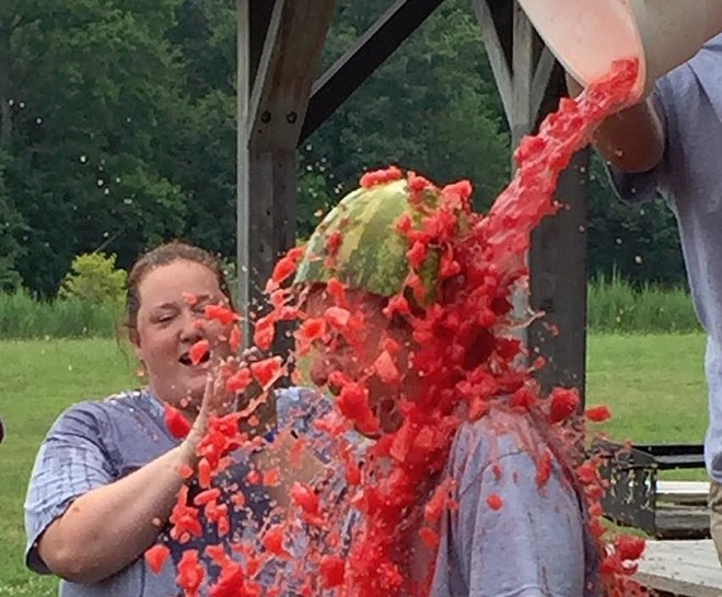 Larry Kaplan enjoys a watermelon shower at his 50 in 30 stop in Delaware.