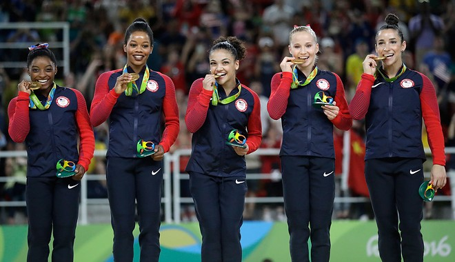 Simone, Gabby, Laurie, Madison and Aly celebrate their team gold win in Rio. - NBCOLYMPICS.COM