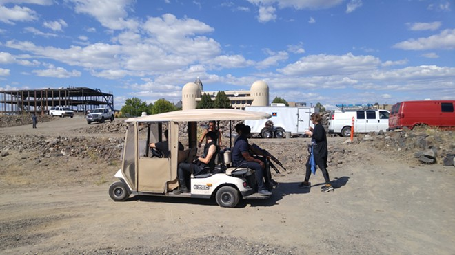 A group of Z-Nation actors hop on a cart for a ride down to a shooting location near the Spokane River.