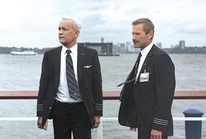 "Tom Hanks (left) plays famed airline captain Chesley ""Sully"" Sullenberger. Aaron Eckhart (right) plays his co-pilot."