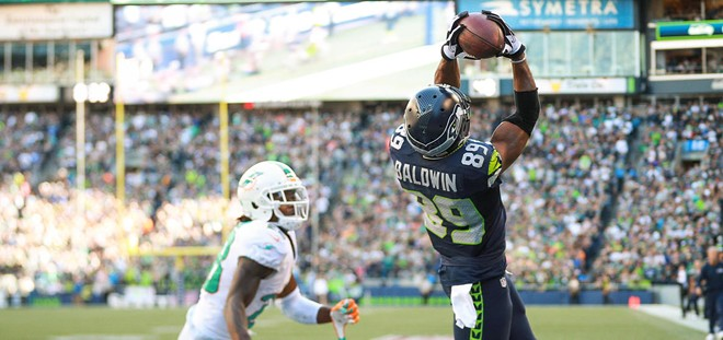 Doug Baldwin makes the winning catch for the Seahawks on Sunday. - SEAHAWKS.COMM