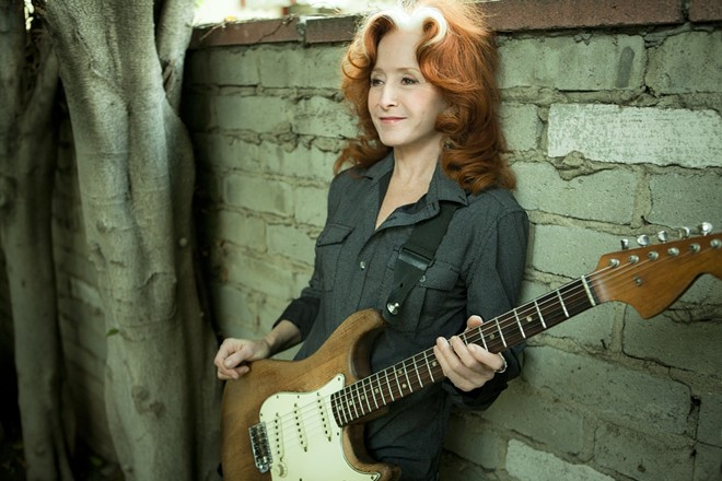 Bonnie Raitt's voice and guitar-playing skills gave Spokane something to talk about last night.