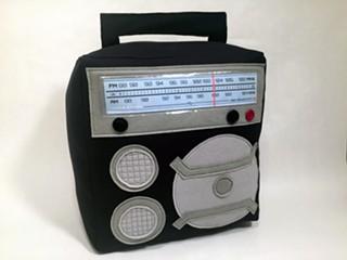 The quirky Burgleteens studio makes fun, handmade accessories like this retro radio throw pillow. - BURGLETEENS.COM