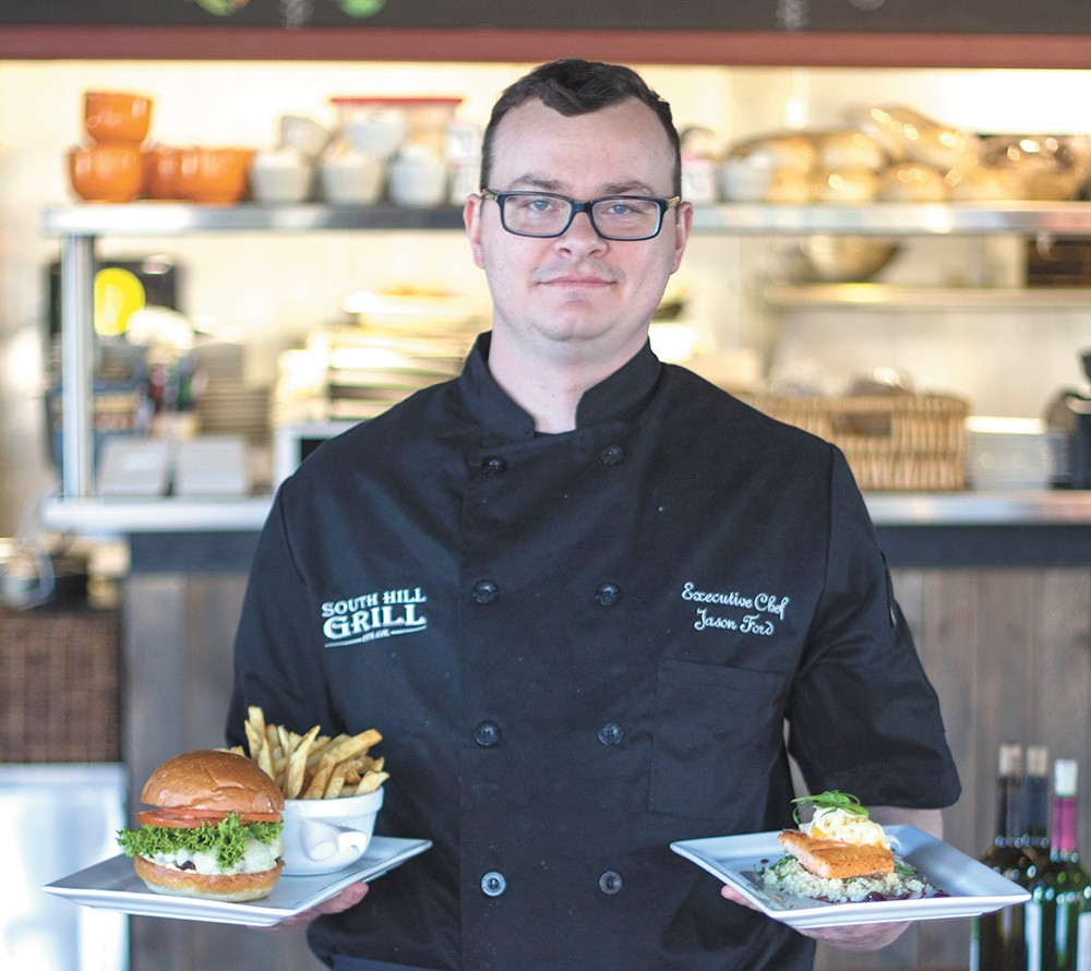 Executive Chef Jason Ford with his South Hill Grill Burger and ginger salmon dish. - MAC BOOEY