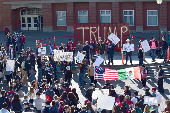 """The scene at WSU today as College Republicans erected a """"Trump Wall,"""" drawing numerous protesters. - TAEHLOR CRIM / MURROW NEWS SERVICE PHOTOS"""