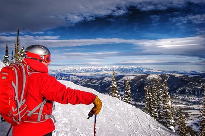 Matt Gibbs taking in the view while using the Powder Alliance beneft at Bridger Bowl outside of Bozeman, Montana.
