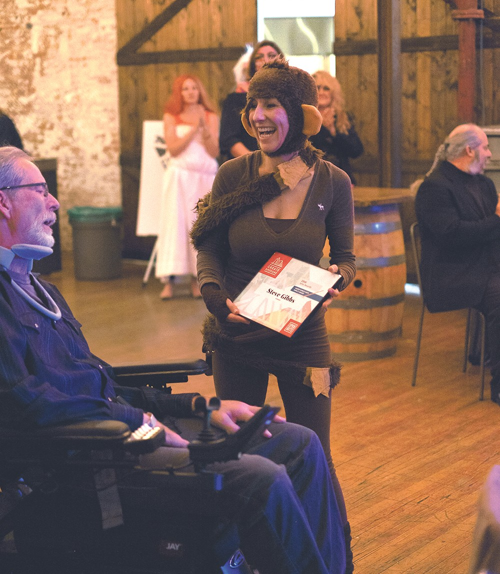 Steve Gibbs receives the Karen Mobley Arts Impact Award from Ellen Picken. - HECTOR AIZON